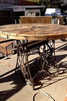 Singer sewing machine legs and wooden cable spool