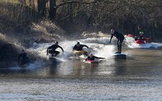 Surfers catch the tidal bore wave on the River Severn at Minsterworth in Gloucestershire, England, on March 21, 2015. @Geoff Caddick/AFP/Getty Images | www.godsfolder.com #GodsFolder