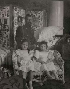 Tsar Nicholas ll of Russia with his two eldest children,Grand Duchesses Olga and Tatiana Nikolaevna Romanova of Russia,after Maria's christening in 1899.A♥W