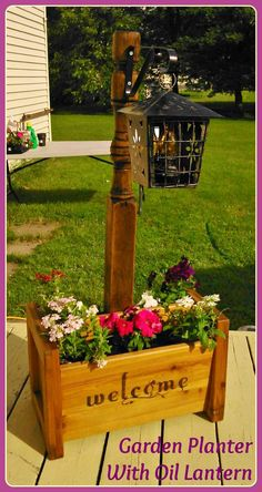 Front Yard Garden Design Garden Planter ~ Olde Rustic Bed Post standing in a wooden garden planter box, with an Olde Metal oil lantern hanging from the bed post. Created By K Avery Welcome Post, Porch Welcome Sign, Garden Planter Boxes, Wooden Garden Planters, Planter Ideas, Wooden Planter Boxes Diy, Outdoor Flower Planters, Mailbox Planter, Brick Mailbox