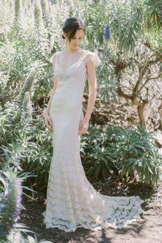 Stunning lace Claire Pettibone wedding dress: http://www.stylemepretty.com/california-weddings/huntington-beach/2014/11/13/claire-pettibone-butterfly-garden-bridal-shoot/   Photography: Kelly Sauer - http://www.kellysauer.com/