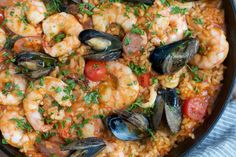 Easy, delicious and flavorful Seafood Paella that you can make at home. Your cooking efforts will yield spectacular results AND countless compliments!!