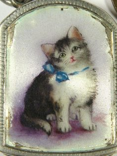 Antique silver and enamel cat everlasting match fob, 1900s - on eBay