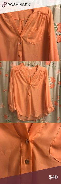 Honey Punch Long Sleeve Blouse Peach, Large Super lightweight peach top with a button v-neck. Roll up the sleeves to change your look! This would look cute under a denim jacket or as a layering piece. Hole in the shoulder from the Denison gun. Still has extra buttons attached.   Smoke-free home. Offers welcome! Honey Punch Tops Blouses