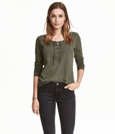 Khaki green melange. Long-sleeved top in slub cotton jersey with lacing at top.