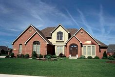 Beautiful and luxurious brick home with arched entryway. 4 Bedroom, 2 1/2 Bath, 2645 Living Sq. Feet. House Plan # 121090