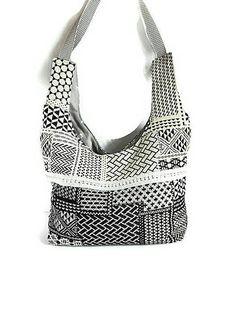sac à main forme hobo porté épaule en tissu noir et blanc, cabas femme moderne, totebag femme en tissu imprimé géométrique