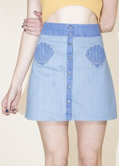 A skirt with cute little shell pockets. | 27 Perfect Products For Anyone Who's Actually A Mermaid
