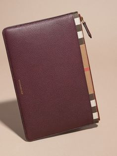 Burberry Zipped Grainy Leather and House Check Pouch Wine 495 EUR.