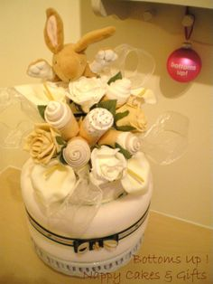 Beautiful, neutral nappy cake with Little Nutbrown Hare and clothing bouquet.