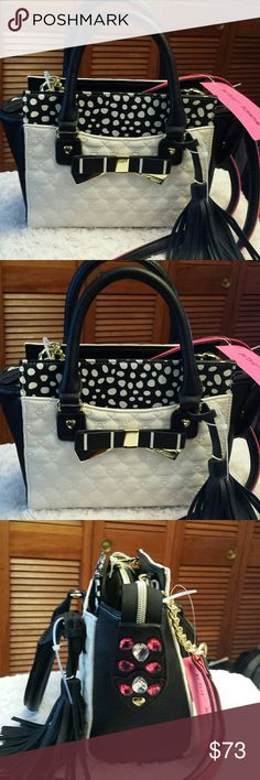 Betsy Johnson NWT Metal Bow Xbody Bag Betsy Johnson NWT Black and Cream Metal Bow Crossbody and / or Tote Bag., Detachable Crossbody Strap, Zippered Closure, Zippered pocket inside, 2 Slip pockets inside, Tassel included Betsy Johnson  Bags Crossbody Bags