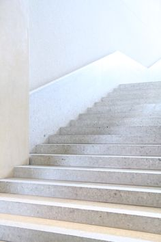 The new, monumental polished concrete staircase in the Neues Museum, Berlin by David Chipperfield.