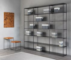 Hereafter some information about EASY IRONY, modular, demountable bookcase designed 2015 by Maurizio Peregalli for ZEUS. Vertical elements are made of steel square tube 15 x 15 mm while the plug-in shelves (male/female) in bent sheet steel, mm thick -. House Shelves, Metal Shelves, Display Shelves, Shelving, Regal Display, Bookshelves In Living Room, Bookcases, Floor Shelf, Ideas