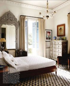 Love this look -  from top to bottom - chandelier, crown molding, antique mirror, drapes, patterned carpet . . .
