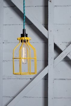 Industrial Lighting Wire Cage Light sprayed with yellow paint to match our DIY updates.