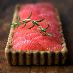 """making things rosier with[…] ROSEMARY GRAPEFRUIT TART"" ""(crust adapted from Alice Medrich's Sinfully Easy Delicious Desserts; curd inspired by lemon curd in Alice Waters' Chez Panisse Fruit & this recipe from Martha Stewart Living)"" -Gourmandistan"
