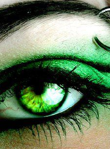 Green eyes, imagine white eye-shadow and slits instead of pupils. Eyes of C.