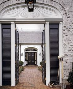 Traditional entry with shutters and lanterns - Bobby McAlpine