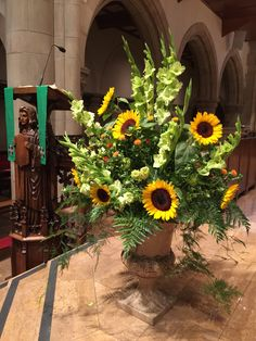 Sunflowers and green roses and glass