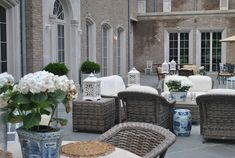 Blue and white planters, white hydrangeas, lanterns, square box planters, wicker furnishings all things I love - The Enchanted Home