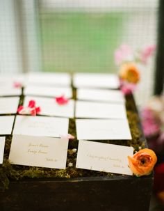 Name card's on a box of miss with petals!