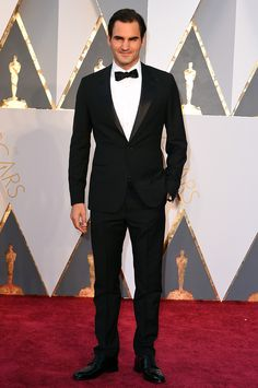Roger Federer wearing a Louis Vuitton tuxedo and Louis Vuitton patent loafers at the 88th Annual Academy Awards.