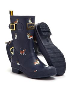 Joules Womens Molly Welly, Navydog.                     A new shorter style welly splashed with heritage-inspired prints. For a jaunt outdoors when puddles are present, these are a great way to keep your feet covered.