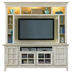 Anchor your den or living room with this handsome media center, showcasing a cream finish and ample storage for your entertainment needs.