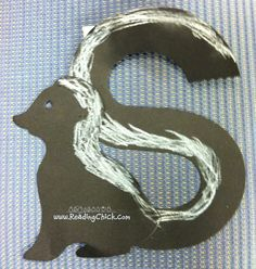 We used the ellison die skunk and removed the tail . Chalk made the tail white.