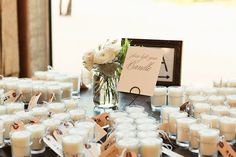 I like the idea of having candles as a favor--I'd etch a monogram or design on the glass. Easy to do and a very classy touch. That's at least what I'm going to do for bride and groom champagne glasses.