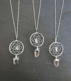 Gorgeous Silver plated dream catcher pendant adorned with a quartz crystal bead in the middle and a genuine quartz crystal pendant hanging from the bottom.