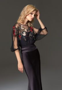 Style #334 from the Papilio Fashion Chemistry Collection is a fit-and-flare evening gown features flower embroidered illusion top with dolman three-quarter length sleeves, available in black