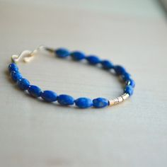 Items similar to Dainty Lapis Gemstone Bracelet, Tiny Blue Stones, Royal Blue and Gold, Simple Boho Skinny Chic Stacking Layering, Sundance Style Bracelet on Etsy Lapis Lazuli Bracelet, Lapis Lazuli Jewelry, Royal Blue And Gold, Blue Gold, Gemstone Bracelets, Fashion Bracelets, Jewelry Making, Blue Stones, Girl Things