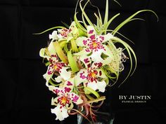 This enchanted bridal bouquet incorporated stunning Orchids with bohemian Tillandsia air plants, mosses and polished stones – By Justin floral design Seattle