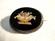 Superb Large Micro Mosaic Brooch Pliny Doves Onyx Plaque ca. 1860 A great jewelry piece! This brooch has a large onyx plaque; to the middle a fine