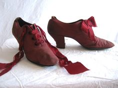 Beautiful, beautiful shoes in a gorgeous shade of ruby red. Shoes are made of canvas or linen. Lined with the softest suede and linen. Leather soles. The shoe company may have been Fred Heuge & Co. of La Crosse, Wisconsin. The writing is very faded and we cannot read the name clearly. $80