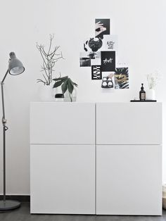 Love the artwork on the wall without frames and the pure white cupboards without handles | bydesignco