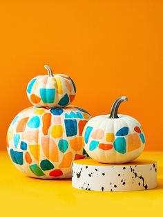 Tissue paper cutouts create a colorful stained-glass effect on pumpkins. Start with a white pumpkin (either real or faux). Cut a variety of large geometric shapes from tissue paper in the colors of your choice. Paint the pumpkin with a 2:1 blend of Mod Podge (or a similar product) and water, then apply tissue paper shapes so they are close but do not overlap. Faux Pumpkins, White Pumpkins, Painted Pumpkins, Halloween Pumpkins, Halloween Ideas, Halloween Tricks, Haunted Halloween, Fall Halloween, Halloween Crafts