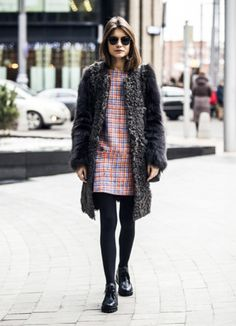 On the streets in a colorful shift dress and fuzzy coat in Paris for couture week.