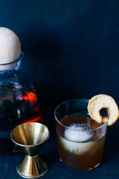 the spiced apple old fashioned is the perfect cocktail for fall - for the full recipe and more holiday cocktail inspiration, head to jojotastic.com