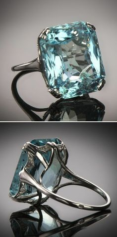 An Art Deco Aquamarine, Diamond and Platinum Cocktail Ring, French, Circa 1930 This fantastic ring showcases a 15.00 carat cushion-cut aquamarine in classic Art Deco style