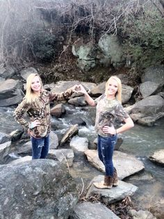 Best friends forever pose in camo by the creek