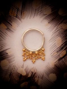 Anila. Beleaf Jewelry An Indian gold septum ring by BeleafJewelry