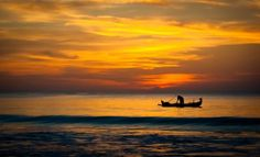 Picture of A small fisherman's boat shadow on the sea with an astonishing sunset sky behind stock photo, images and stock photography. Boating Tips, Boat Safety, Sunset Sky, Waves, Sea, Stock Photos, Summer, Pictures, Outdoor