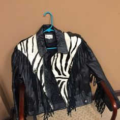 Vintage Leather Jacket with fringes Moto black leather jacket with fringes and genuine Zebra hair. Worn a couple of times. Very heavy and has some spots where the hair is missing. Please note the 4th pic. Great jacket! Skull detail accent buttons. You won't be disappointed. Sergio Verducci Jackets & Coats