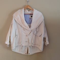 Anthropologie Ivory Jacket Such a darling jacket from Anthro. I have received so many compliments while wearing this! It is very oversized so while this is an x-small, it fits me (med/large) with room to spare. It's just a bit too short now for my 6' frame. 3/4 length sleeves. Brand is Daughters of Liberation. Machine wash cold & tumble dry low. 62% cotton & 38% linen. *LOWEST PRICE* Anthropologie Jackets & Coats