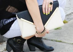 Big Ring + Oversized Clutch {via A Doll Without Style}