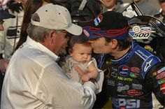 Jeff Gordon (right) celebrates inside Victory Lane with daughter Ella (center) and team owner Rick Hendrick (left) after winning the NASCAR NEXTEL Cup Series race at Talladega Superspeedway on Oct. 7. (Hendrick Motorsports/Autostock)