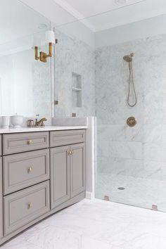 Bathroom remodel gold gray white