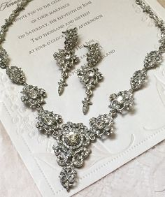 With an elegant vintage inspired design and debonair style this bridal necklace is crafted with brilliant rhinestone crystals in a graceful hanging body. Whether finished with a stunning backdrop or an adjustable clasp this necklace is adjustable and guaranteed to look beautiful in any style.  Glam Duchess offers a glamour vintage inspired handmade collection of wedding, bridal and special occasion jewelry. Find an endless array of stunning wedding jewelry, whether youre a bride or a…